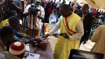 Mayor Yeah Samake publicly paying his taxes before the people of Ouelessebougou