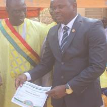Deputy Ousmane Kouyate, previous Secretary General who served under Yeah, is awarded a certificate for his work on behalf of the people of our great city